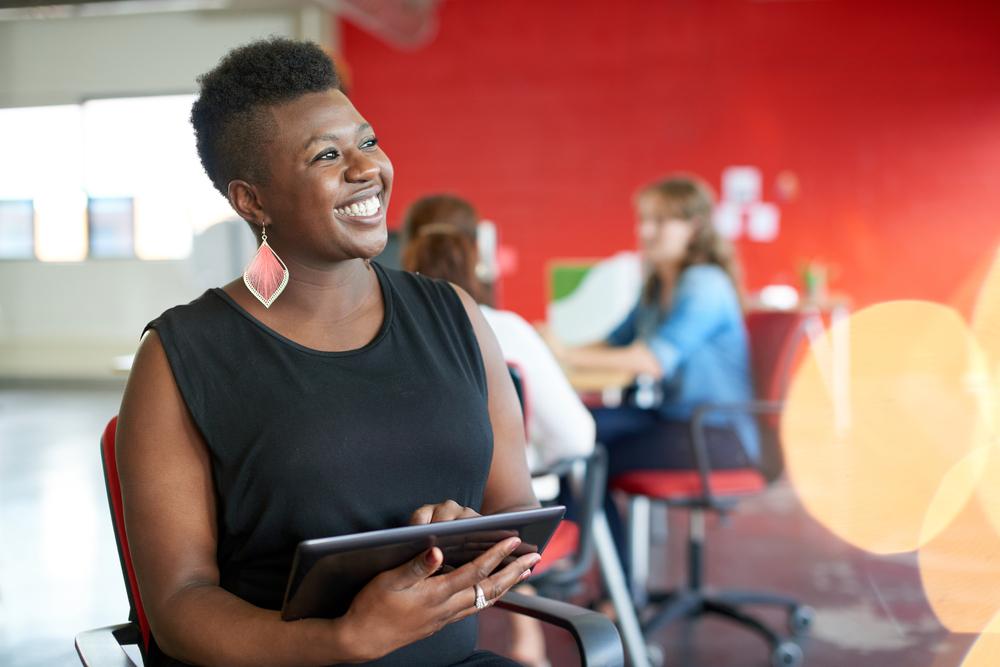 Confident,Female,Designer,Working,On,A,Digital,Tablet,In,Red